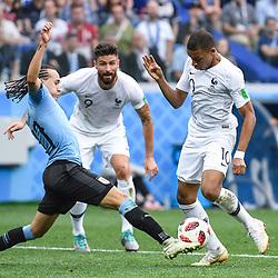 Diego Laxalt of Uruguay and Kylian Mbappe of France during 2018 FIFA World Cup Quarter Final match  between France and Uruguay at Nizhniy Novgorod Stadium on July 6, 2018 in Nizhniy Novgorod, Russia. (Photo by Anthony Dibon/Icon Sport)