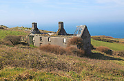 Abandoned ruined farmhouse building on west coast of Cape Clear Island, County Cork, Ireland, Irish Republic
