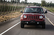 USA, Oregon, Willamette Mission State Park, Jeep Patriot driving. MR, PR