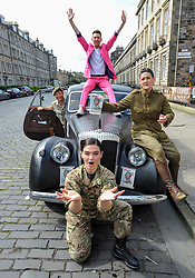 Pictured: Performer Nick Alban, from show the Happiness Prohect poses on the roof of a vintage car driven by Brigadier Robin Lindsay Commander 51 Brigade, along with opera singer Lila Palmer  (front) and Teiya Kasahara (right) from the show Dead Equal.<br /> <br /> The Army at the Fringe venue opened it's doors today, with five shows on. <br /> <br /> © Dave Johnston / EEm