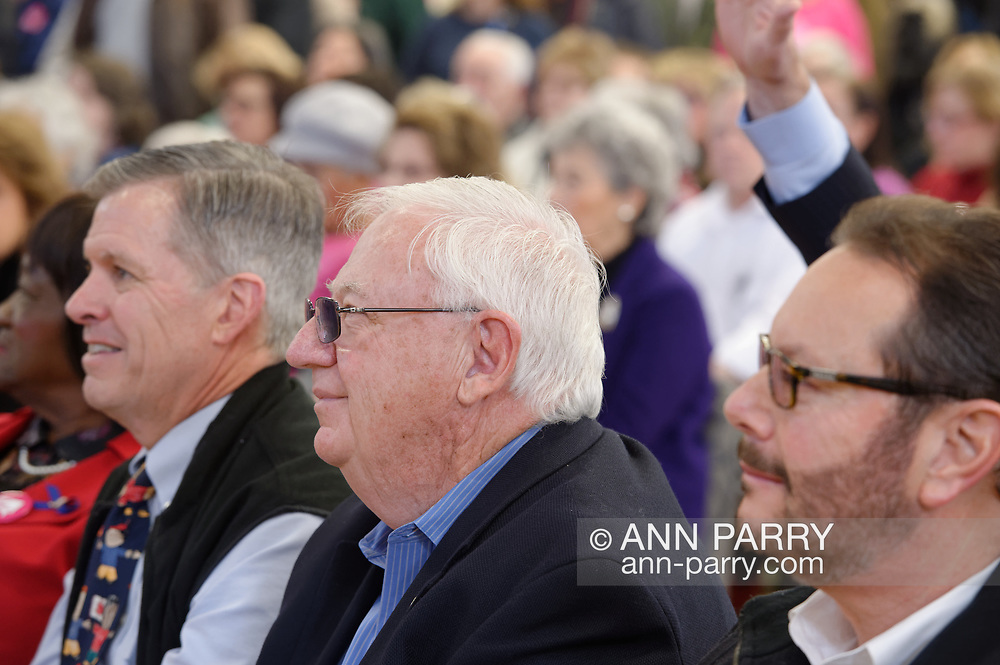 "Westbury, New York, USA. January 15, 2017. NYS Senator JOHN E. BROOKS (Dem.- District 8), at center with white hair, along with other local Democratic politicians, sits in the front rows of the ""Our First Stand"" Rally against Republicans repealing the Affordable Care Act, ACA, taking millions of people off health insurance, making massive cuts to Medicaid, and defunding Planned Parenthood."