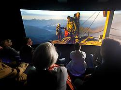 18.06.2011, Kitzsteinhorn, Kaprun, AUT, AUT, GIPFELWELT 3000, KITZSTEINHORN, ERÖFFNUNG, im Bild Zuschauer im Cinema 3000, auf einer acht Meter langen Leinwand werden hier Filme über den Nationalpark und den Gletscherbahnen Kaprun den Zuschauern gezeigt. Bild aufgenommen während der Eröffnung der Gipfelwelt 3000 am Gletscher Kitzsteinhorn bei Kaprun, Salzburgerland, Österreich, EXPA Pictures © 2011, PhotoCredit: EXPA/ J. Feichter., EXPA Pictures © 2011, PhotoCredit: EXPA/ J. Feichter