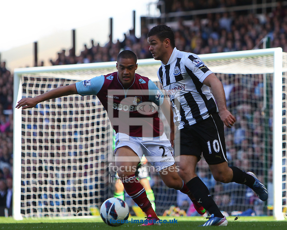 Picture by John Rainford/Focus Images Ltd +44 7506 538356.04/05/2013.Winston Reid of West Ham United and Hatem Ben Arfa of Newcastle United during the Barclays Premier League match at the Boleyn Ground, London.