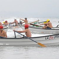 Lifeguards compete in the Dory during the  Santa Monica Pier Paddleboard Race and Ocean Festival on Saturday, June 11, 2011.