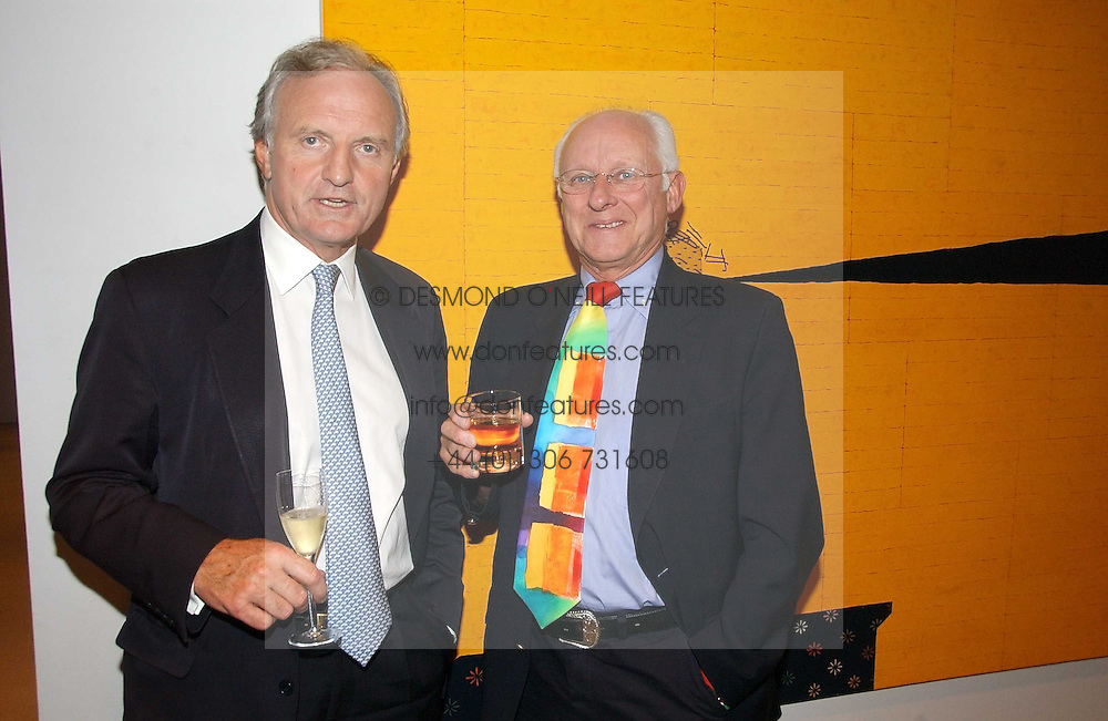 Left to right, MR CHARLES ANSON former Press Secretary to HM The Queen and DICKIE ARBITER former press officer at Buckingham Palace,at a party to celebrate the publication of Diana by Sarah Bradford held at 80 The Strand, London on 27th September 2006.<br />