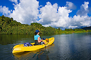 Woman kayaking on the Hanalei River, Island of Kauai, Hawaii