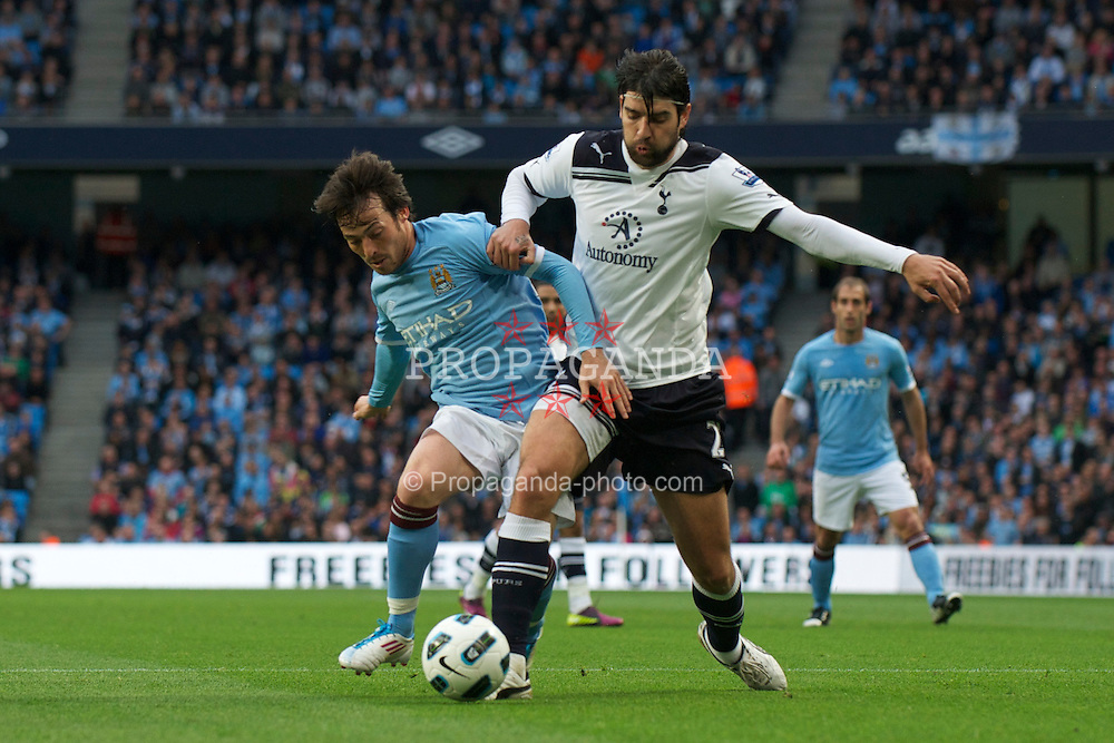 MANCHESTER, ENGLAND - Monday, May 10, 2011: Manchester City's David Silva and Tottenham Hotspur's Vedran Corluka during the Premiership match at the City of Manchester Stadium. (Photo by David Rawcliffe/Propaganda)