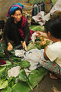Woman selling goods at rural day market