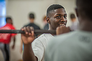 BEAUFORT, SC - JULY 14: CJ Cummings talks with a fellow lifter on July 14, 2014 at the Beaufort Middle School weight lifting facility in Beaufort, South Carolina. The 14-year-old will attempt to break the U.S. record for the clean and jerk lift of 152.5 kg (336 pounds) when he competes at the Open Men's Nationals later this month. (Photo by Stephen B. Morton for The Washington Post)