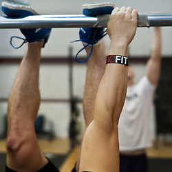 Dustin practices toes to bar, Crossfit image, picture, photo, photography of health, elite, exercise, training, workouts, WODs, taken at Progressive Fitness CrossFit,Colorado Springs, Colorado, USA.