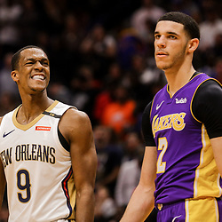 Mar 22, 2018; New Orleans, LA, USA; New Orleans Pelicans guard Rajon Rondo (9) smiles towards Los Angeles Lakers guard Lonzo Ball (2) during the fourth quarter at the Smoothie King Center. The Pelicans defeated the Lakers 128-125. Mandatory Credit: Derick E. Hingle-USA TODAY Sports