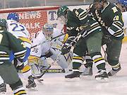 NMU's Jared Brown (15) gets ready to backhand the puck past LSSU goalie Brian Mahoney-Wilson (35) for one of his two third period goals Saturday night at Taffy Abel Arena in Sault Ste. Marie.