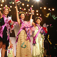 "BEIJING, 18 DECEMBER 2004: Cheng Lili, Feng Qian and Zhang Shuang, winners of  the ""first worldwide artificial beauty pageant "" celebrate in a theatre in Beijing, 18 December , 2003, in China...Beauty business in China , from cosmetic surgeries to hair brush sales, has amounted to more than USD 7 billion in 2003. The contest for women who have undetgone plastic surgery was organized after Yang Yuan, a young would-be model, was disqualified earlier on this year when organizers discovered that she'd had plastic surgery. Yang was present during the contest to introduce her biography that explains why she has the right to ""improve"" her natural features..."