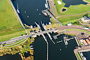 Nederland, Groningen, Gemeente Marne, 04-11-2018; Zoutkamp, voormalige vissersdorp aan de Lauwerszee, nu Lauwersmeer. Bekend van het vissen op en verwerken van garnalen (firma Heiploeg). Het Reitdiep gaat over in Zoutlamperril, richting Lauwersmeer.<br /> Former fishing village on the Lauwerszee.<br /> luchtfoto (toeslag op standaard tarieven);<br /> aerial photo (additional fee required);<br /> copyright &copy; foto/photo Siebe Swart