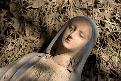 01 October, 05.  New Orleans, Louisiana. Lower 9th ward. Hurricane Katrina aftermath. <br /> The remnants of the lives of ordinary folks, now covered in mud as the flood waters recede.A statue of the Virgin Mary lies covered in mud. <br /> Photo; ©Charlie Varley/varleypix.com
