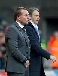 SWANSEA, WALES - Sunday, March 11, 2012: Swansea City's manager Brendon Rodgers and Manchester City's manager Roberto Mancini during the Premiership match at the Liberty Stadium. (Pic by David Rawcliffe/Propaganda)