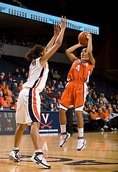 Clemson guard Christy Brown (4) shoots over Virginia forward Lyndra Littles (1).  The Virginia Cavaliers women's basketball team defeated the Clemson Tigers 83-71 at the John Paul Jones Arena in Charlottesville, VA on February 21, 2008.