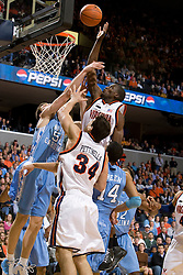 Virginia guard/forward Mamadi Diane (24) puts back a shot over North Carolina forward Tyler Hansbrough (50).  The Virginia Cavaliers men's basketball team fell to the #3 ranked North Carolina Tar Heels 75-74 at the John Paul Jones Arena in Charlottesville, VA on February 12, 2008.
