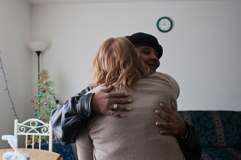 "Horizons volunteer coordinator Anna Ronnebaum hugs  Meals on Wheels client Michelle Dawson at Dawson's home in Cedar Rapids, Iowa on Thursday, November 19, 2015. Michelle, who lately has been suffering after a violent incident at her home. ""I'll have to make sure I get this route again next week so I can go check on her,"" said Ronnebaum after leaving the apartment. (Rebecca F. Miller/Freelance for The Gazette)"