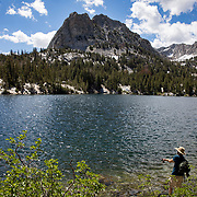 Crystal Lake trail leads to beautiful Crystal Lake with snow still covering the mountain into August.