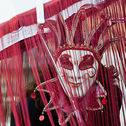 VENICE, ITALY - FEBRUARY 20:   A woman wearing Carnival red costume and mask poses in St Mark Square on February 20, 2011 in Venice, Italy. The Venice Carnival, one ofthe largest and most important in Italy, attracts thousands of people from around the world each year. The theme for this year's carnival is Ottocento amd Sissi, a nineteenth century evocation, andwill runfrom February 19 till March 8.