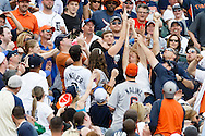 May 24, 2014; Detroit, MI, USA; Fan (right) reaches up to grab a foul ball in the fifth inning during the game between the Detroit Tigers and the Texas Rangers at Comerica Park. Mandatory Credit: Rick Osentoski-USA TODAY Sports