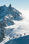 Photo of five alpinists descenting Aiguille du Mide on a steep ridge towards Vallee Blanche