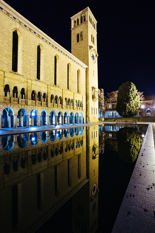 Night scene of Winthrop Hall refected in the Reflection Pool. University of Western Australia.