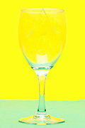 broken wineglass  object on yellow green background