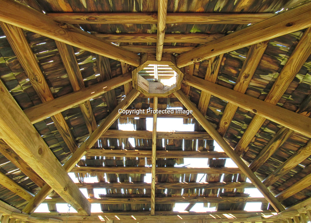 Sunlight pours through holes in the roof of the gazebo. The estimated cost to repair the roof is nearly $1,000 — too much, town officials said.