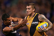 PERTH, AUSTRALIA - JUNE 05: Dustin Martin of the Tigers fends off Danyle Pearce of the Dockers during the round 10 AFL match between the Fremantle Dockers and the Richmond Tigers at Domain Stadium on June 5, 2015 in Perth, Australia.  (Photo by Paul Kane/Getty Images)