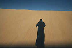 Shadow man in the dunes on Mandora Station