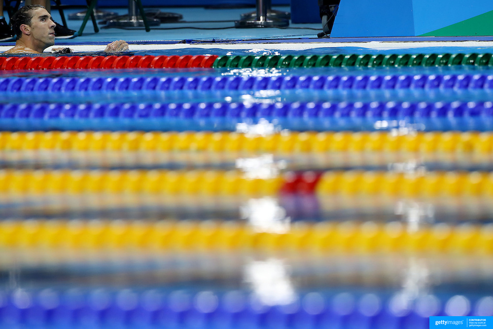 Swimming - Olympics: Day 6   Michael Phelps of the United States leaves the pool after  the Men's 100m Butterfly Semifinal  during the swimming competition at the Olympic Aquatics Stadium August 11, 2016 in Rio de Janeiro, Brazil. (Photo by Tim Clayton/Corbis via Getty Images)