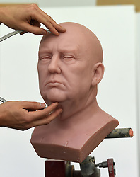 Principal Sculptor David Gardner measures an unfinished wax figure of President-elect Donald Trump at the Madame Tussauds studio in west London, which will be released in January.