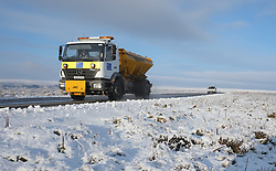 © Licensed to London News Pictures. <br /> 27/12/2014. <br /> <br /> Castleton, United Kingdom.<br /> <br /> A gritter lays salt on a road on the North Yorkshire Moors near Castleton after overnight snowfall caused disruption in some parts of the country.<br /> <br /> Photo credit : Ian Forsyth/LNP