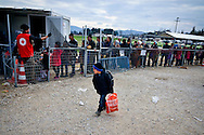 Refugees and migrants wait in line to enter a refugee camp at Idomeni village, Greece, as they wait to cross the Greek-Macedonian border,8 Febraury 2016.<br /> Hundreds of refugees arrive at Idomeni and cross the border between Greece and Macedonian on their journey to North Europe.
