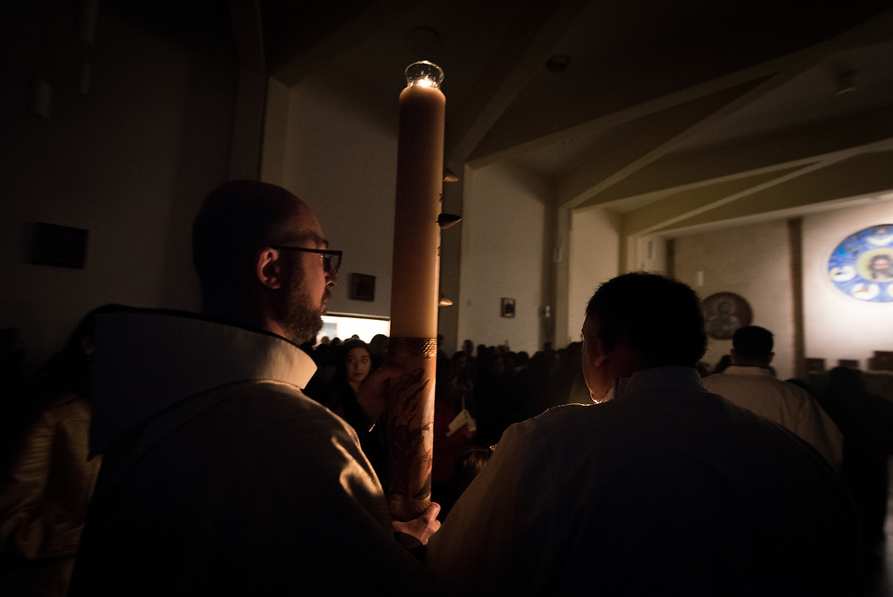 20 April 2019, Jerusalem: Father Bernard leads the procession into Holy Saturday service at Saint James' Church in Beit Hanina, Jerusalem.