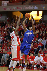 03 January 2009: Justin Carter takes a fading jump shot over the raised arms of Champ Oguchi.  The Illinois State University Redbirds extended their record to 14-0 with a 86-64 win over the Creighton Bluejays on Doug Collins Court inside Redbird Arena on the campus of Illinois State University in Normal Illinois