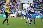 Referee Stephen Martin shows a yellow card to Sheffield Wednesday Defender Jack Hunt during the Sky Bet Championship match between Reading and Sheffield Wednesday at the Madejski Stadium, Reading, England on 23 January 2016. Photo by Phil Duncan.
