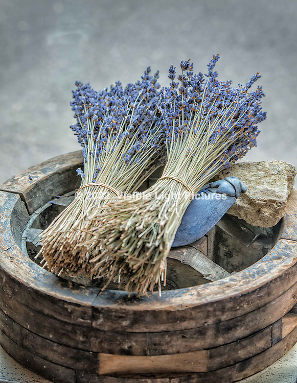 Two bunches of dried lavender in a French gift shop.