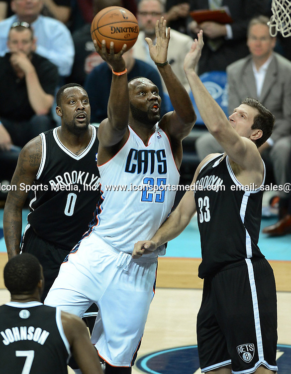 March 26, 2014 - Charlotte, NC, USA - The Charlotte Bobcats' Al Jefferson (25) drives to the basket as the Brooklyn Nets' Mirza Teletovic (33) defends in the second half on Wednesday, March 26, 2014, at Time Warner Cable Arena in Charlotte, N,C. The Bobcats won in overtime, 116-111