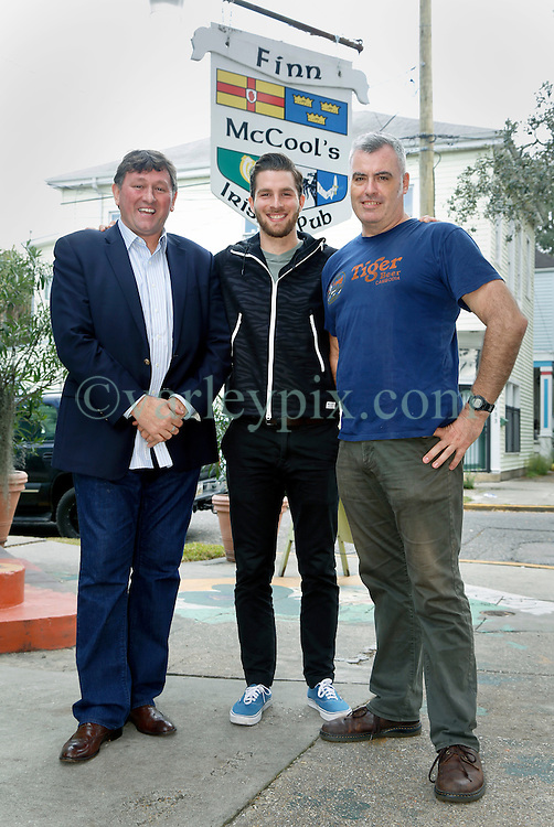 23 November 2015. Finn McCool's Irish Pub, New Orleans, Louisiana.<br /> Major League Soccer (MLS) star player Patrick Mullins of New York City FC poses for a photo with New Orleans Jesters Head Coach Kenny Farrell (l) and Steve Patterson (r) owner of Finn McCool's.<br /> Photo©; Charlie Varley/varleypix.com