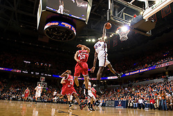 Virginia guard/forward Mamadi Diane (24) goes up for a dunk against NCSU.  The Virginia Cavaliers men's basketball team defeated the North Carolina State Wolfpack 78-60 at the John Paul Jones Arena in Charlottesville, VA on February 24, 2008.