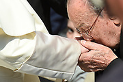 VATICAN CITY 04 OCTOBER 2017: A Priest kisses the hand of the Pope Francis on October 04, 2017 at Saint Peters Square in Vatican City, Rome, Italy.