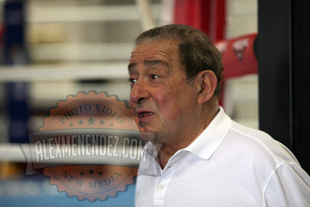 Top Rank Promoter Bob Arum talks to the media as his fighter  Miguel Cotto holds media day at K.G. Boxing Gym in Orlando, Florida on Monday, Nov. 21, 2011. Cotto will be defending his World Boxing Association (WBA) super welterweight title against rival Antonio Margarito at Madison Square Garden in New York City, on December 3.  (AP Photo/Alex Menendez)