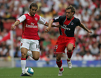 Photo: Lee Earle.<br /> Arsenal v Paris Saint-Germain. The Emirates Cup. 28/07/2007.Arsenal's Mathieu Flamini (L) battles with Jerome Rothen.