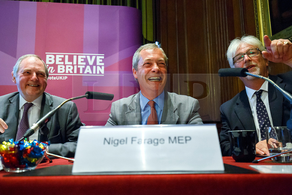 """© Licensed to London News Pictures. 17/06/2015. London, UK. UKIP leader NIGEL FARAGE delivers a speech with UKIP MEPs William Dartmouth (L) and Steve Crowther (R) to launch """"The Truth About Trade Beyond The EU"""" pamphlet in central London, on Wednesday, June 17, 2015. Photo credit: Tolga Akmen/LNP"""