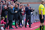 Heart of Midlothian manager Craig Levein and the Hearts bench applaud the first goal by Ryotaro Meshino (#77) of Heart of Midlothian FC during the Ladbrokes Scottish Premiership match between Heart of Midlothian and Rangers FC at Tynecastle Park, Edinburgh, Scotland on 20 October 2019.