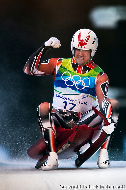 Samuel Edney of Canada celebrates after finishing his fourth run of the Men's Single Luge competition during the 2010 Vancouver Winter Olympics at the Whistler Sliding Centre in Whistler, Canada, on Feb. 14, 2010. Edney finished in seventh place.