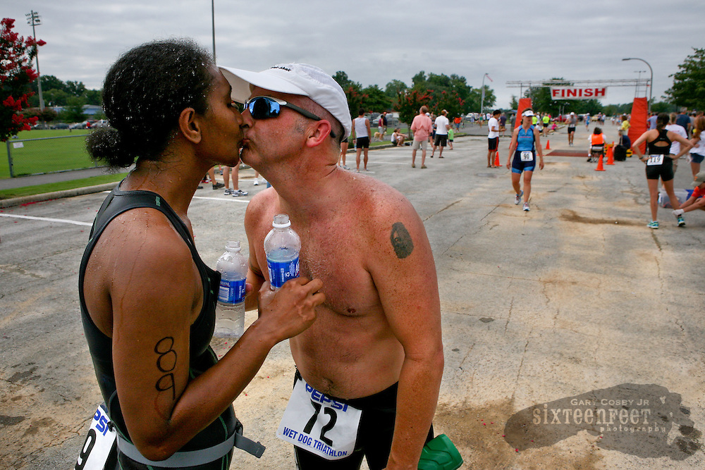 Daily Photo by Gary Cosby Jr.    ..Betty Pat and Richard Clement kiss following the Wet Dog Triathlon in Point Mallard Park Saturday morning.  The couple are dating and did the triathlon together.